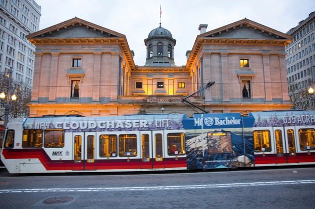The MAX train passes by Pioneer Courthouse in downtown Portland. Nearly half of crimes committed on TriMet occur on rail, according to a new report.