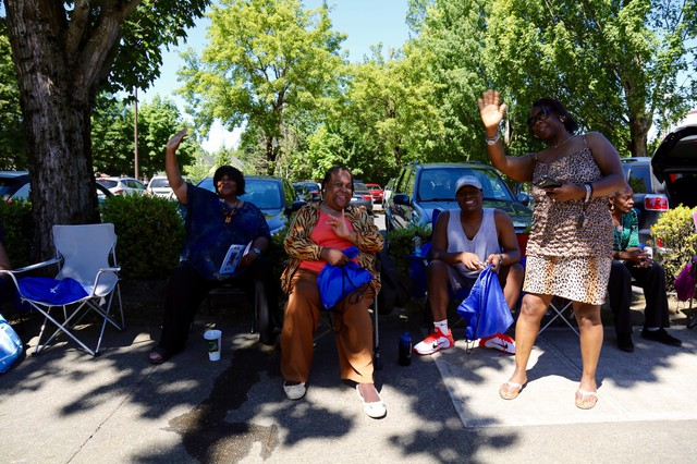 Residents waveas the Good in the Hood parade marched down Martin Luther King Jr. Blvd in Northeast Portland.