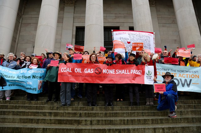 Opponentsof a proposed oil terminal in Vancouver, Washington, gather on the steps of the Capitol building in Olympia.