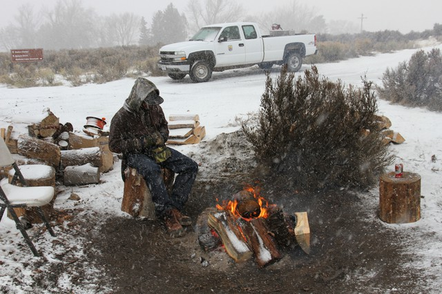 A new militant from Arkansas guards the entrance to the occupied refuge on Jan. 14.