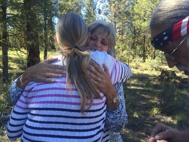 Jeanette Finicum hugs a supporter after a Father's Day celebration at the site of her husband's death along U.S. Route 395.