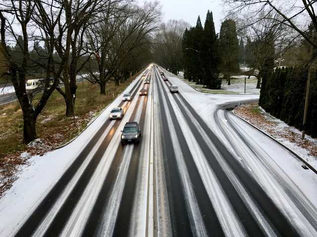 Snow blankets Highway 99E through Portland on Sunday, Dec. 24, 2017.