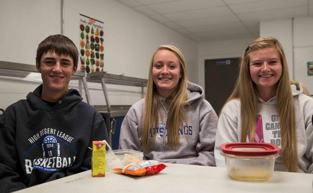 """Jordan Valley high school students Nick Eiguren, Andi Warn and Jaci Larsen bring their lunches from home most days. They say they don't miss the lunch program. """"I don't think kids are that bummed out about it, actually,"""" says Warn."""