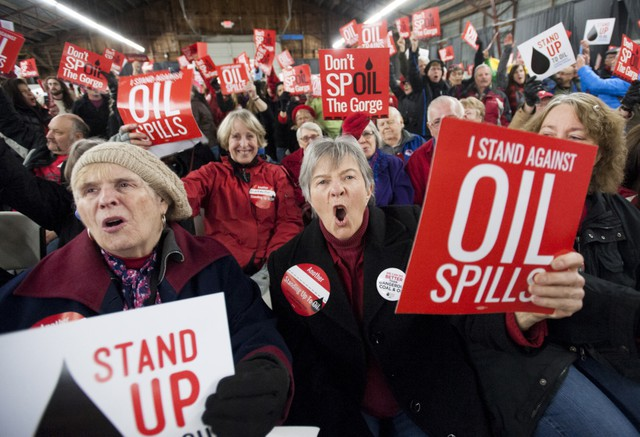 One among hundreds of demonstrators, Maureen Hildreth, center, voices her opposition to the Vancouver Energy oil terminal at an anti-terminal rally Jan. 5 at the Clark County Event Center at the Fairgrounds. The campaign Stand Up To Oil organized the rally, and others like it, to tap into the strong regional distaste for fossil fuel projects.