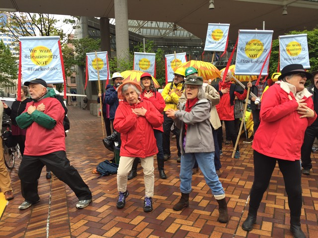 """Protesters danced to their own version of """"YMCA"""" in which they asked PGE why the utility is considering natural gas when wind and solar energy would be better for the planet."""