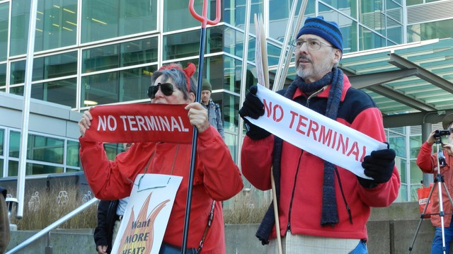 Climate activists protest a propane export terminal proposed for the Port of Portland.