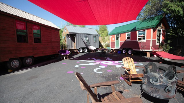 The Caravan Tiny House Hotel consists of three tiny homes on a lot in Northeast Portland