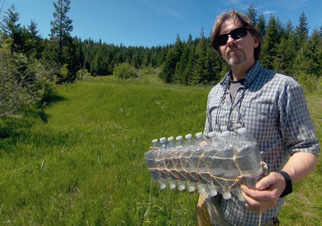 Oregon Fish and Wildlife biologist Simon Wray holds a homemade float consisting of water bottles, string and duct tape. He's been using homemade equipment to study turtles in the Rogue Valley for 23 years.