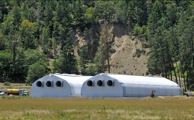 Recreational marijuana greenhouses erected near Highway 238 in Williams, Oregon, look like rockets laid on their sides.
