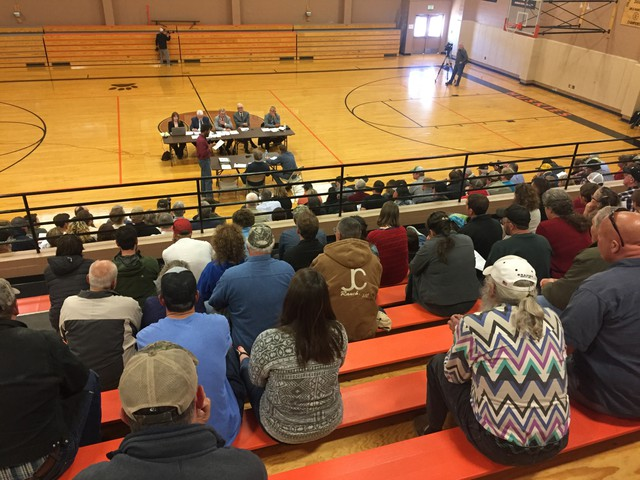 About 300 people filled the bleachers at the Sherman County High School to discuss whether a large organic farm is letting its weeds spread onto neighboring property — and whether the government should do something about it.