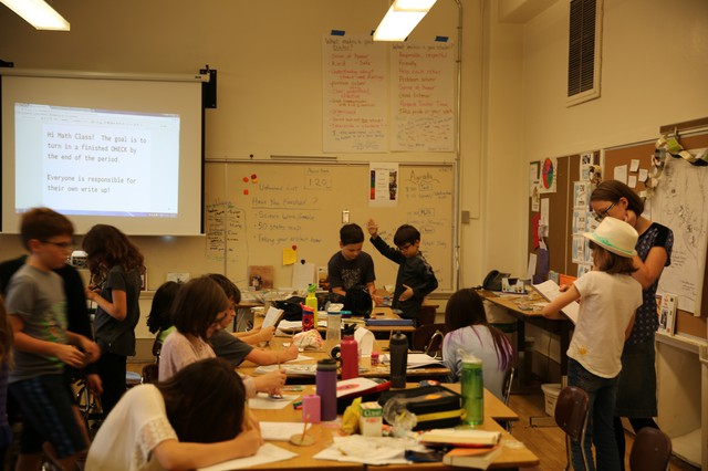 Fourth grade students at the ACCESS Academy work in a classroom in the Rose City Park school building, in June 2017.