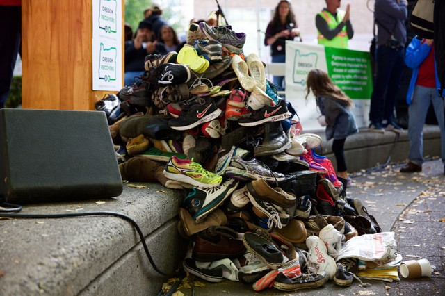 A pile of shoes labeled with the name of someone lost to alcohol or drug addiction at a rally for recovery on Sept. 30, 2017.