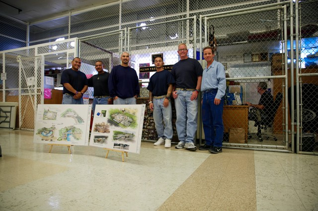 Members of the Asian Pacific Family Club at the Oregon State Penitentary stand in front of the club's small office space inside the prison. In front of them are designs for a healing and restorative garden they're working to buildatthe prison. From left to right: Jimmy Kashi, Walter Taitinfong, Johnny Cofer, Toshio Takanobu, Kevin O'Hara and Scott Bitter.