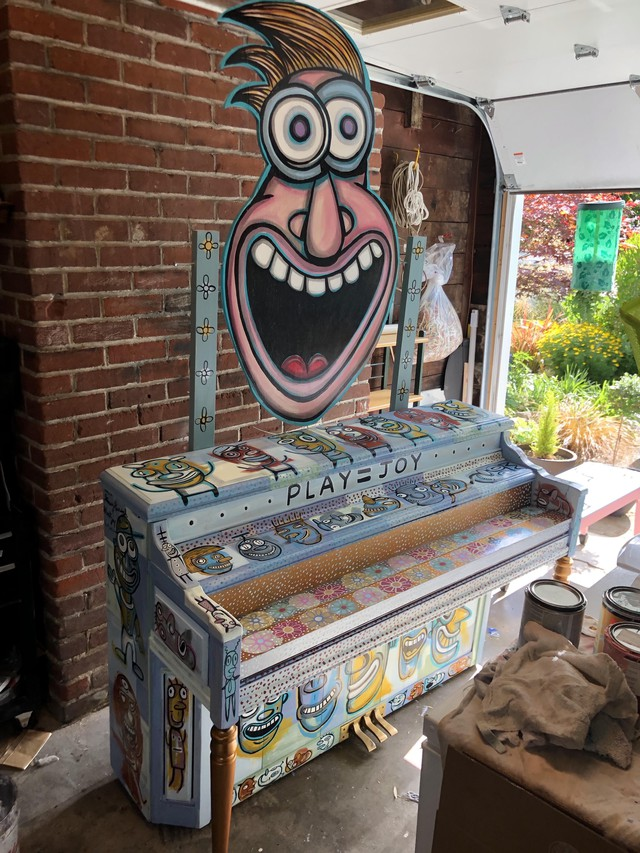 A piano decorated by artist Gary Hirsch for Piano. Push. Play.