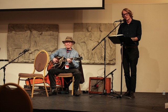 "Author Patrick Dewitt (right) reads a passage from his book ""Undermajordomo Minor,"" accompanied by Michael Hurley on guitar at Wordstock."