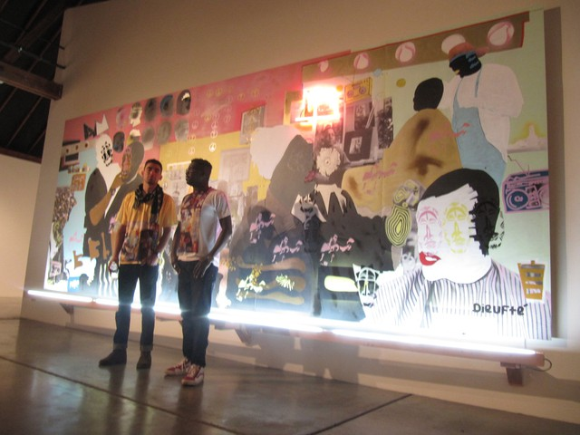 Devon Van Houten-Maldonado (left) and Modou Dieng (right) were one of Hunt's picks. Their huge canvas is one of the centerpieces of theshow.