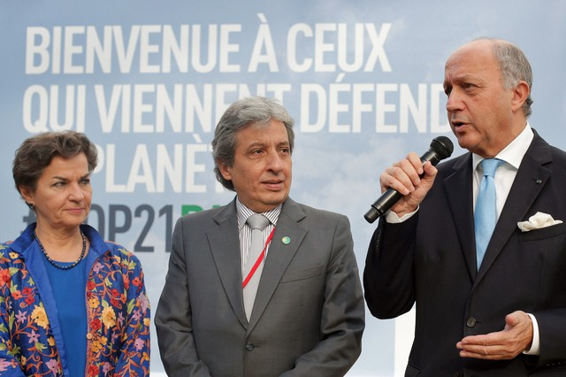 United Nations climate chief Christiana Figueres, left, Minister of the Environment of Peru and COP20 President Manuel Pulgar-Vidal, and French Foreign Affairs Minister, and COP 21, President Laurent Fabius, talk to media during a press visit of the COP21, Paris Climate Conference, site, in Le Bourget, north of Paris.