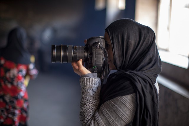 "Afghan photographer Farzana Wahidy is featured in the film ""Frame By Frame."""