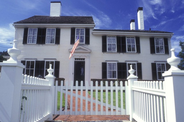 """A large home with a white picket fence is at the heart of the mythology around the """"American Dream."""""""