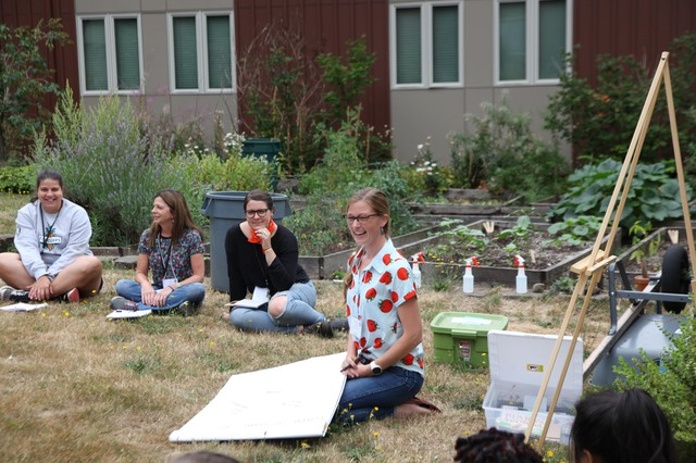 Jenna Mobley leads a lesson on worms at FoodCorps training in Portland.