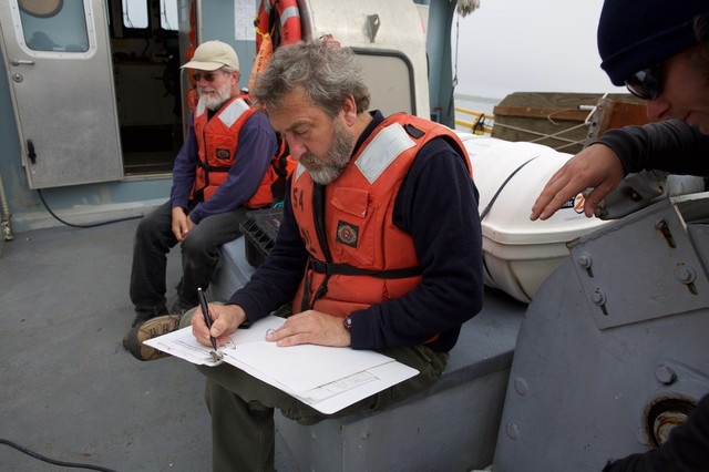 NOAA fisheries biologist, Curtis Roegner records scientific data on the health of crab populations. Low-oxygen levels have killed off large populations of crabs during hypoxia events in the past.