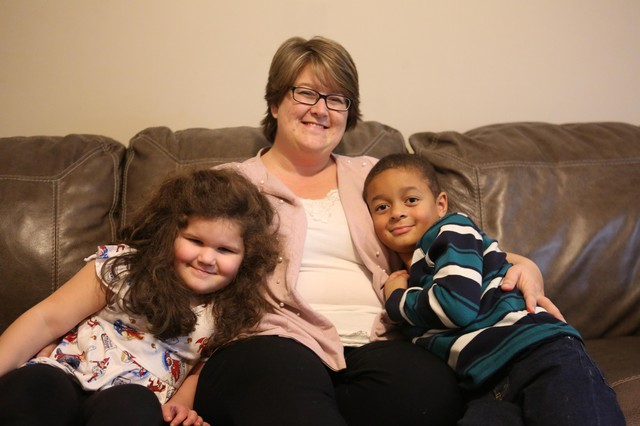 Christina Walker with her son, Evan, and her daughter, Olivia, in their Portland, Tennessee, home. Walker fostered Olivia for two years before the adoption, and worked through a number of serious behavior issues with the help of Youth Village's Intercept program.
