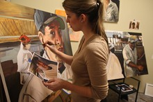 Painter Natalie Sept works on a portrait for The Dishwasher Project.