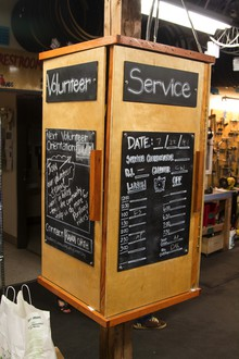 The volunteer and service sign-up board inside the Community Cycling Center