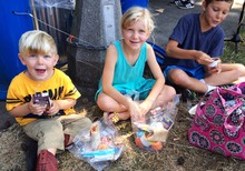 Linus, Ada and Cody eat their free summer meal in Peninsula Park.