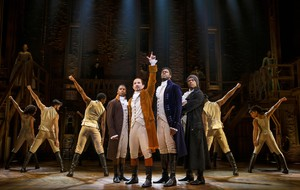 "At center, left to right, Elijah Malcomb as John Laurens, Joseph Morales as Alexander Hamilton, Kyle Scatliffe as the Marquis de Lafayette and Fergie L. Philippe as Hercules Mulligan in the second national tour of ""Hamilton."""