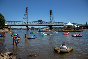 The 8th Big Float event, taking place in front of the Hawthorne Bridge at the Tom McCall Waterfront Park in downtown Portland, Ore., is hosted by the Human Access Project to encourage people to swim in the Willamette River.