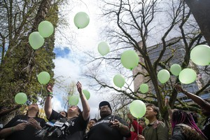 Larnell Bruce Jr.'s family releases green balloons after the sentencing hearing of Russell Courtier on April 16, 2019 in Portland, Oregon.