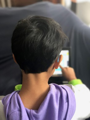 Nadia Hasan's son works on his school-supplied Chromebook.