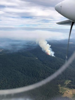 A small fire burns in a remote area of Silver Falls State Park in Oregon.