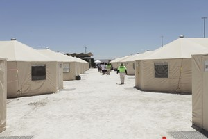 The undated photo released by U.S. Department of Health and Human Services shows detainees walk in a line at the HHS' unaccompanied alien children program facility at Tornillo, Texas. The tents used at the facility are manufactured by Eugene-based Western Shelter Systems.