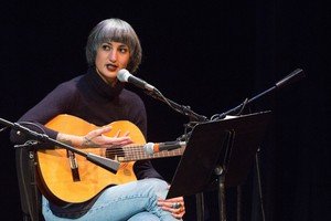 """Luz Elena Mendoza from Y La Bamba speaks with OPB """"State Of Wonder"""" Host April Baer at Wordstock at the Dolores Winningstad Theatre in Portland, Oregon, Saturday, Nov. 5, 2016."""