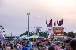 A smoky sun sets on Salem at the Oregon State Fair.