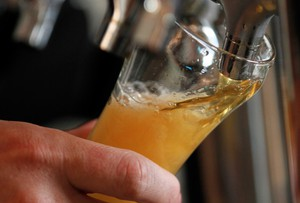 In this Aug. 20, 2012, file photo a brewer pours a sample of beer. America loves its beer and its fine dining, so why is it so hard to find the perfect pairing of the two?