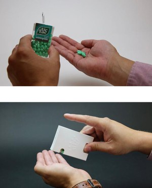 One of the BillerudKorsnäs paper replacements for a plastic box works just like a Tic Tac dispenser, but it employs a paper spring to release the mints.