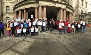 Protesters including theRaging Grannies, as well Oregon Physicians for Social Responsibility, Friends of the Columbia Gorge and high school students from the Portland Youth Climate Council, gathered in front of City Hall on Wednesday, March 13, to oppose the expansion of Zenith Terminals, which could increase the number of oil trains moving through Portland.