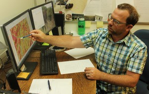 Oregon State University professor Chris Dunn examines a map of the likelihood of success for fire suppression in southern Oregon. Dunn is part of a Forest Service team using data to improve decision-making and risk assessment.