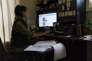 Tatiana Resetnikov scrolls through news feeds about Douglas County's Second Amendment Preservation Ordinance in her home on Oct. 25, 2018 in Winchester Bay, Oregon. Resetnikov is an activist organizing opposition to the ordinance which she says gives too much power to he sheriff.