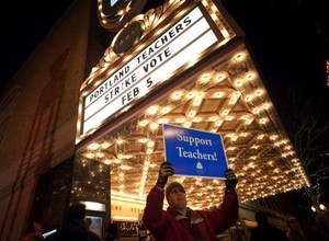 David Child, a member of the Portland Association of Teachers bargaining team, held a sign outside the Arlene Schnitzer Concert Hall in February 2014 during a rally to support teachers as a possible strike loomed. The teachers union voted to authorize a strike on Feb. 5, 2014.