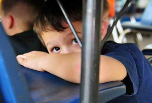 Child participates in earthquake drill