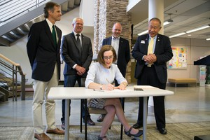 Gov. Kate Brown signs Senate Bill 81 at Columbia Gorge Community College on July 17.
