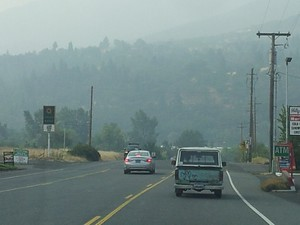 Driving into Ashland, Oregon, the hills are shrouded in wildfire smoke.