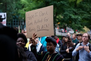 "People show their anger at Thursday's ""This Can't Be Justice"" solidarity protest in wake of the killings of Philando Castille and Alton Sterling."