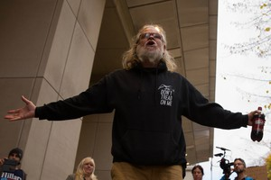 "An occupation supporter shouts ""Free the Hammonds"" outside the federal courthouse in Portland. The 41-day occupation of the Malheur National Wildlife Refuge was partly driven by the resentencing of Harney County ranchers Dwight and Steven Hammond."
