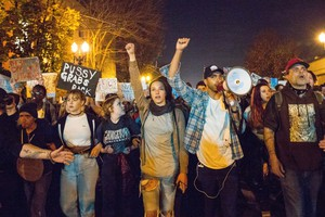 Portland activist and law student Gregory McKelvey, second from right, leads a march down Highway 99E on Thursday, Nov. 10, 2016.