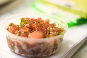 "Poke means ""to slice"" or ""cut crosswise"" in Hawaiian."